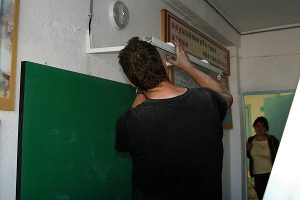 Lamp boven het schoolbord